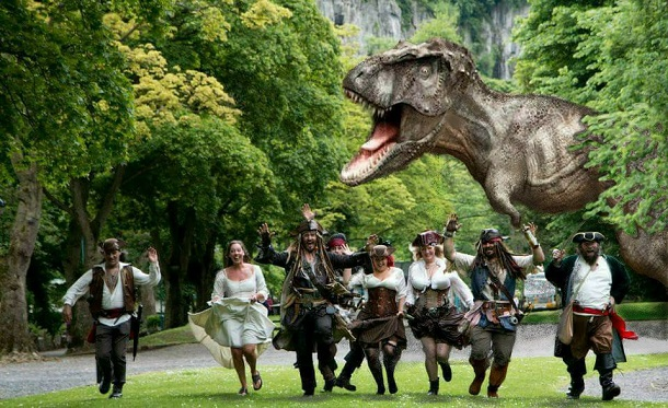 pirates chased by dinosaur