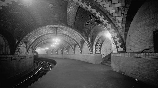 There is an abandoned subway station under the City Hall in New York that you can see as you pass by on the 6 train