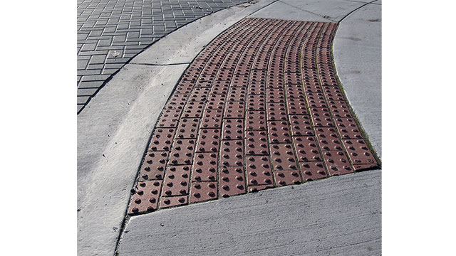 In some countries there are specific textures (tactile pavements) in the sidewalks that blind people can sense with their canes and use for guidance. These are especially useful near crosswalks and metros