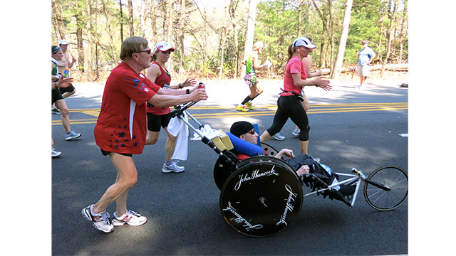 Dick Hoyt ran 247 triathlons while pushing, pulling, or carrying his disabled son