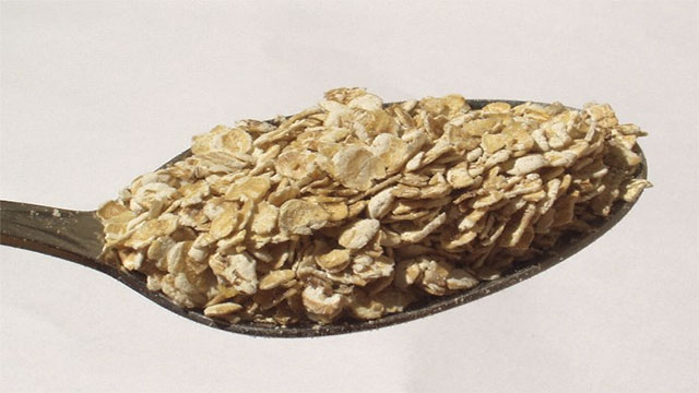 Instant oatmeal is just regular rolled oatmeal cut smaller so that the hot water will work more quickly (along with some sugar and powdered milk). Basically you could make the same thing with a blender