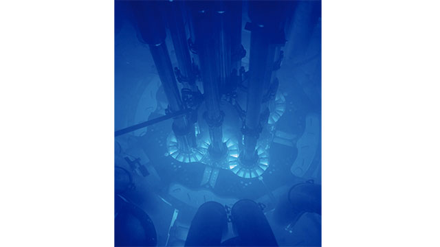 Cherenkov radiation is what happens when a particle travels through a medium (like water) faster than light would. This radiation gives off a blue glow that is characteristic of underwater nuclear reactors