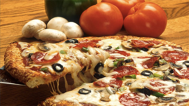 If the radius of a pizza is Z and its thickness is A, then its volume is PI*Z*Z*A