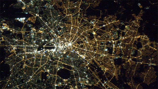 The former dividing line between east and west Berlin can still be seen from space. West Berlin uses modern white colored lights while east Berlin still uses older yellow colored lights.