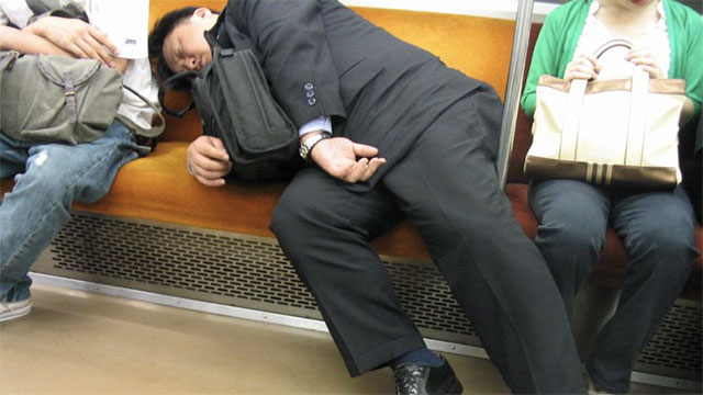Businessmen passing out in public