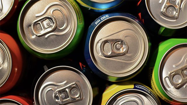The colored dots found on soda cans near the nutrition facts represent the colors used in the can design. This allows the company to troubleshoot their printers if one of the dots is faded or missing.