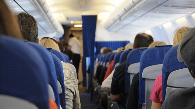 Over reclining airplane seats without asking