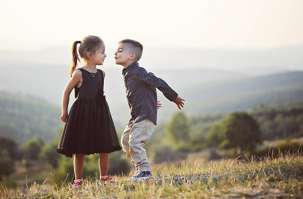 boy and girl about to kiss