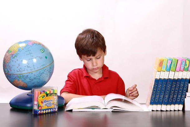 kid learning how to read