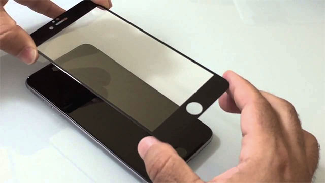 Putting a screen protector on a phone