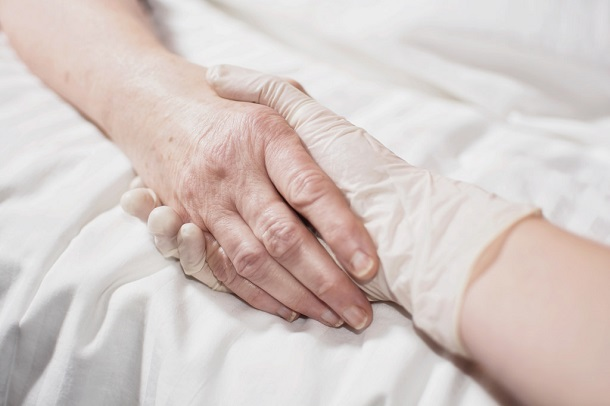 hands holding in hospital