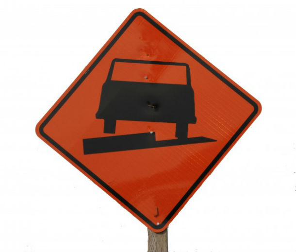 uneven-pavement-highway-sign