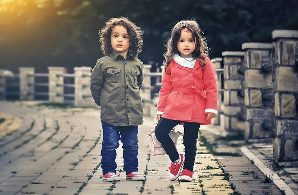 two kids standing next to each other
