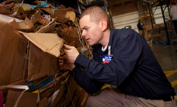 walmart_employee_placing_bale_wire_on_boxes