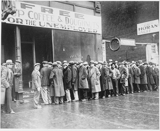 1464px-Unemployed_men_queued_outside_a_depression_soup_kitchen_opened_in_Chicago_by_Al_Capone,_02-1931_-_NARA_-_541927