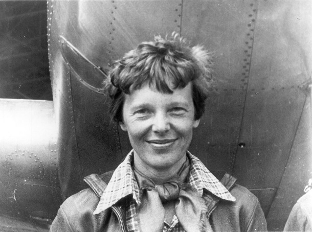 Amelia_Earhart_standing_under_nose_of_her_Lockheed_Model_10-E_Electra_small
