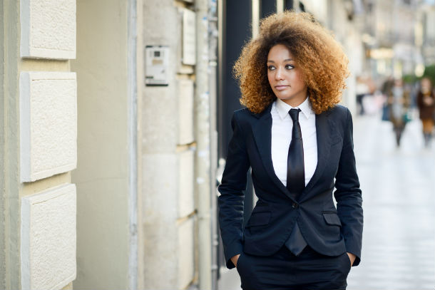 woman in suit and tie