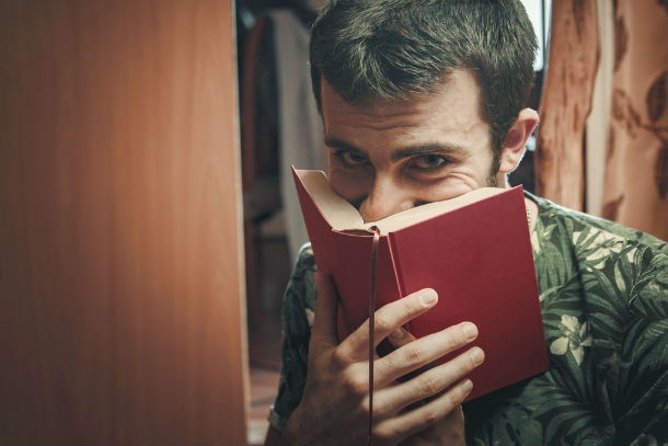 man smelling a book
