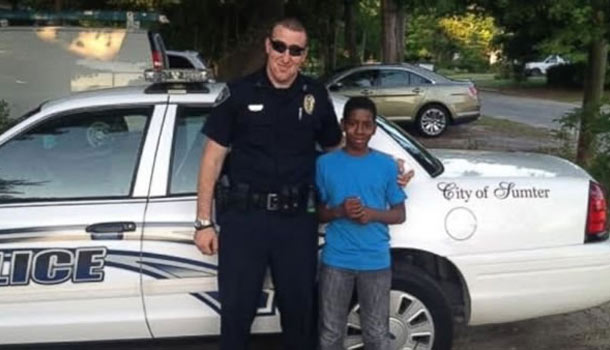 Officer Gaetano Acerra standing next to 13-year-old Cameron Simmons