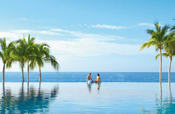 Couple at Dreams Resort Cabo in the pool