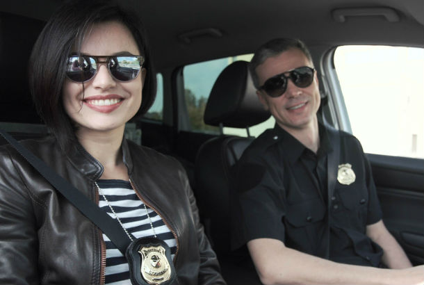 two police officers sitting in a police car