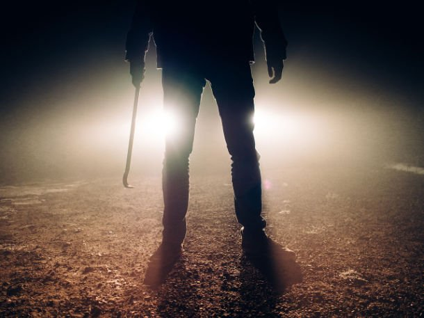 shadow of man with weapon