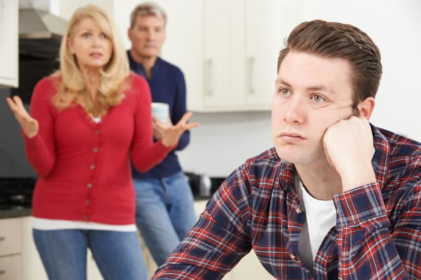 man living with exasperated parents