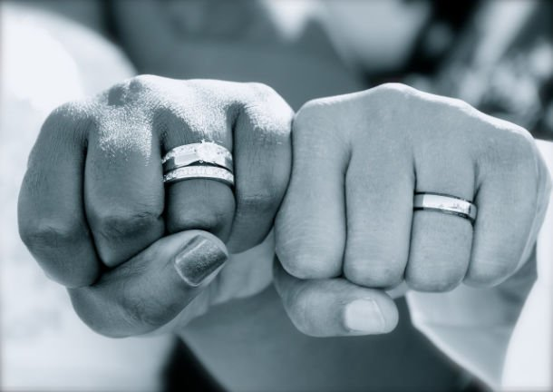 fists showing off wedding rings