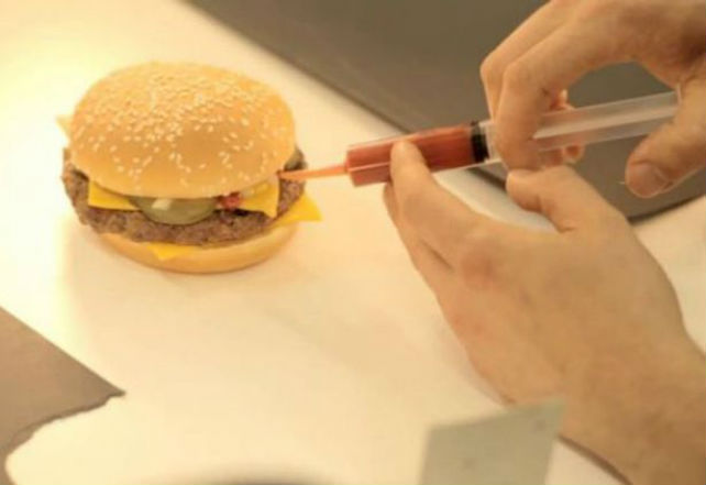 mcdonalds-burger-being-dressed-up-to-look-its-best-for-an-advert-tomato-ketchup-is-being-inserted-via-a-syringe-904355