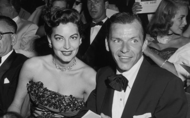 100 Iconic Star Queens - feature - source: Hulton Archive:  American actress Ava Gardner (1922 - 1990) and her husband, American singer and actor Frank Sinatra (1915 - 1998) at the Hollywood premiere of director George Sidney's film 'Show Boat', in which Gardner stars.  Pic ref:      02f/27/haft/15307/03
