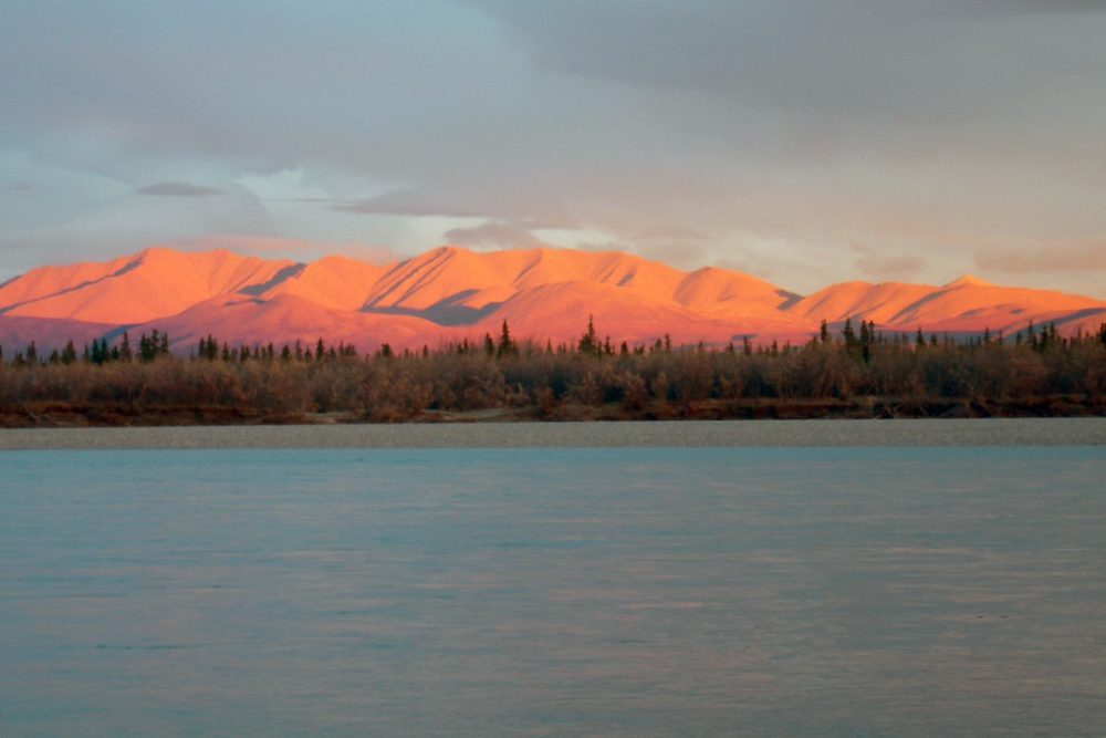 The setting sun casts a spectacular pink light on the Maiyumerak Mountains which lie on the south side of the Noatak River.